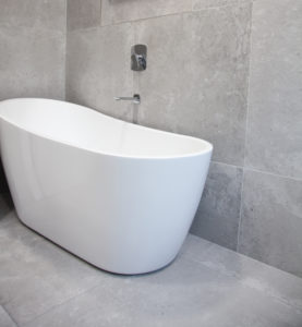 White Bath in Grey Bathroom www.tilemerchant.ie