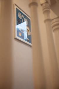 Framed print on wall