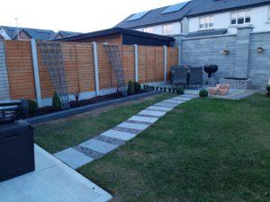 Back garden that contains 20mm porcelain paving