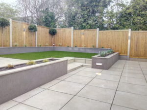 Outdoor porcelain patio with artificial grass section