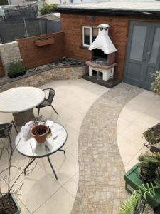 20mm porcelain paving with natural stone decorative feature