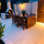 BBQ area created with 20mm porcelain paving at night