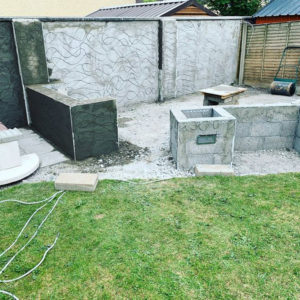 Brian Redmond back garden that contains 20mm porcelain paving at night