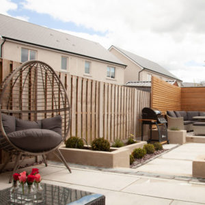 20mm porcelain patio with garden furniture and barbecue