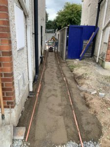 Path being installed beside a house