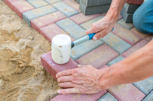 Landscapers Installing Natural Stone Paving with mallet